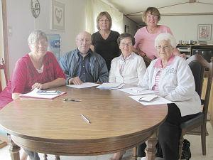 Acme History Book Committee donates funds to Acme Community