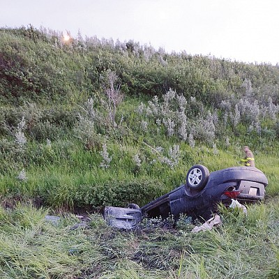 Driver survives 60-foot plunge into coulee