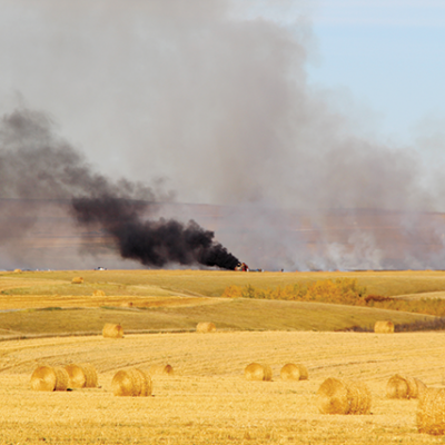 Combine lost in harvest fire